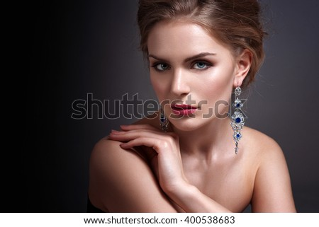 Beautiful woman with evening make-up. Jewelry and Beauty. Fashion photo. - stock photo