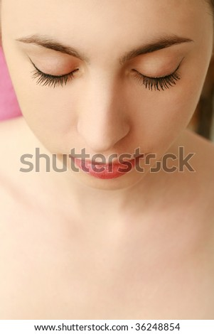 beautiful woman with eyes closed - stock photo