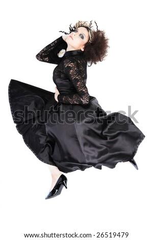 Beautiful woman with fashion hairstyle wearing black dress on white - stock photo