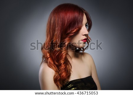Beautiful woman with fashionable red hairstyle - stock photo
