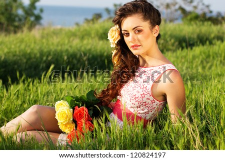 Beautiful woman  with flowers in her hair - stock photo