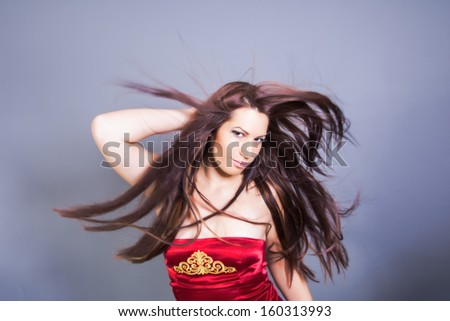 beautiful woman with fluttering hair - stock photo