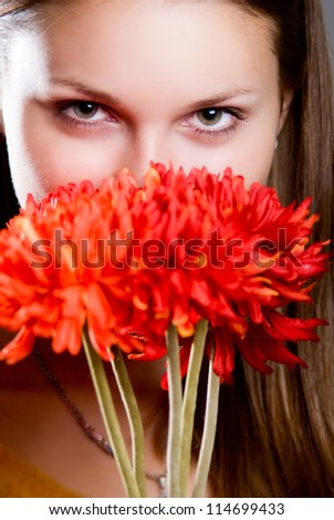 Beautiful woman with fresh health skin of face and red flower. - stock photo