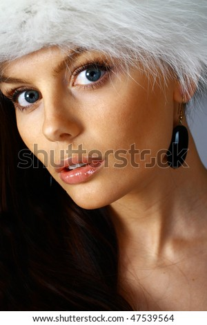 Beautiful woman with fur hat - stock photo