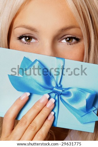 beautiful woman with gift - stock photo