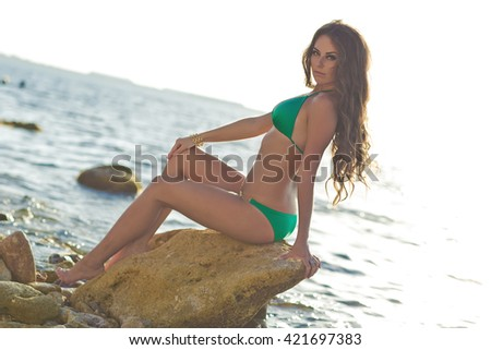 Beautiful  woman with glamour makeup and long hair. Sexy look. Girl in swimsuit. - stock photo