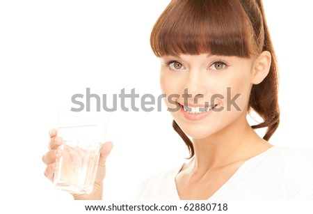 beautiful woman with glass of water over white - stock photo