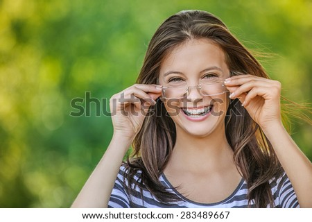 beautiful woman with glasses and braces in her teeth. - stock photo