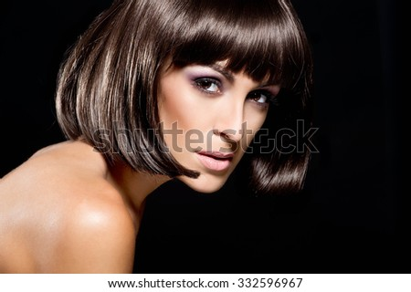 Beautiful woman with glossy hair. Hairstyle Kare. Hair care - stock photo