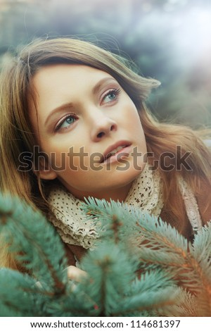 Beautiful woman with green fir - Christmas concept - stock photo
