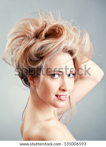 Beautiful woman  with hairstyle  over grey background - stock photo