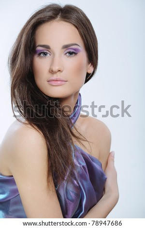 Beautiful woman with health skin in violet color dress - stock photo