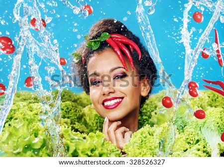 Beautiful woman with healthy food and water splashes - stock photo