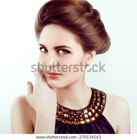 Beautiful woman with healthy pale glowing skin, gray eyes and red hair smiling - stock photo