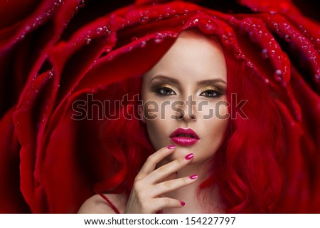Beautiful Woman with Healthy Red Hair and rose  - stock photo