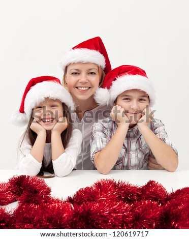 Beautiful woman with her kids at christmas time - stock photo