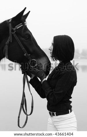 Beautiful woman with horse in black and white - stock photo