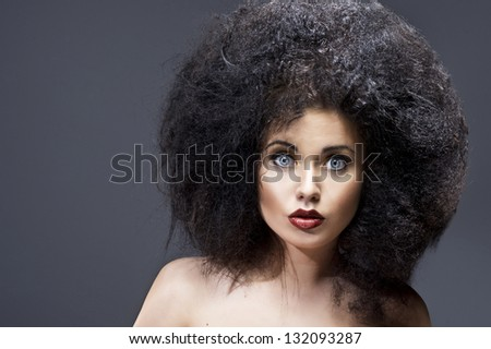 Beautiful woman with huge afro - stock photo