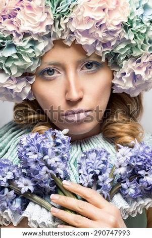 Beautiful woman with hyacinth flowers - stock photo