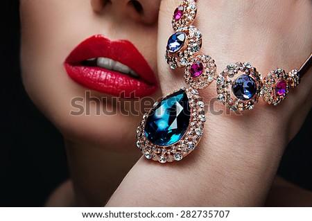 beautiful woman with jewelry, close-up - stock photo