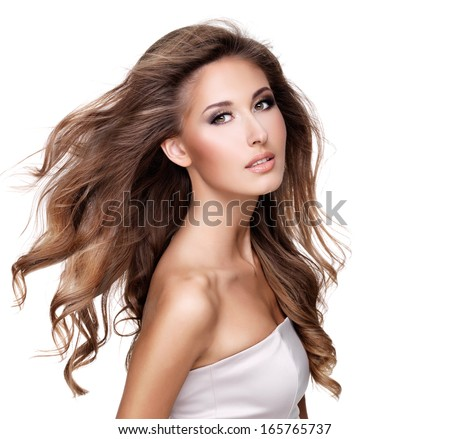 Beautiful woman with long brown hair in movement and makeup. Isolated on white - stock photo