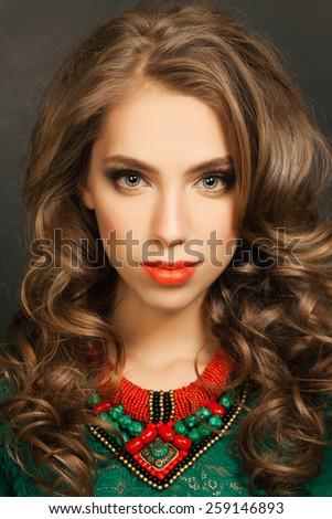 Beautiful woman with long curly hair, face closeup - stock photo
