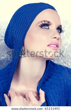 beautiful woman with long eyelashes happy smiling on silver background - stock photo