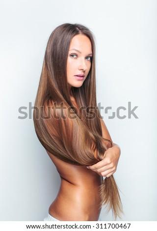 beautiful woman with long hair - stock photo