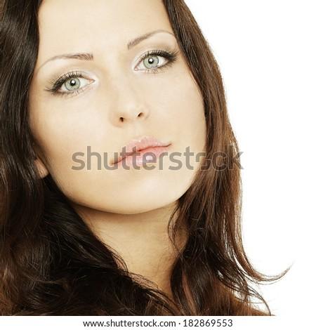 Beautiful woman with long hair and makeup, face closeup - stock photo