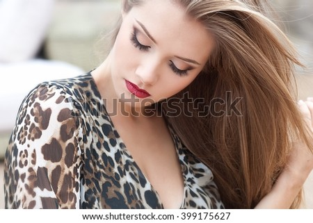 Beautiful woman with long hair in spring time. - stock photo