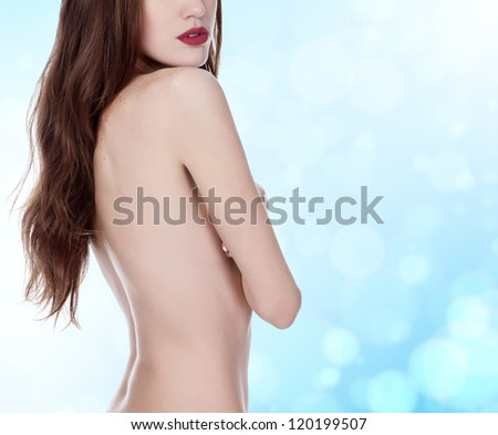 beautiful woman with long hair on blue blurred background - stock photo