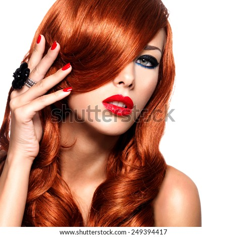 Beautiful woman with long red hairs with sexy bright lips and red nails.  Portrait of a fashion model with covered face by hairs  -  isolated on white. - stock photo