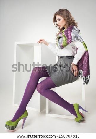 beautiful woman with long sexy legs dressed casual posing in the studio - full body - stock photo