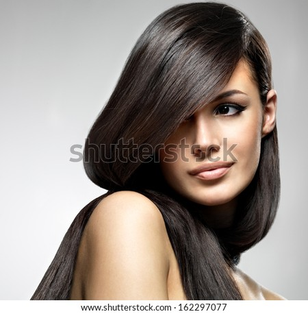 Beautiful woman with long straight hair. Fashion model posing at studio. - stock photo