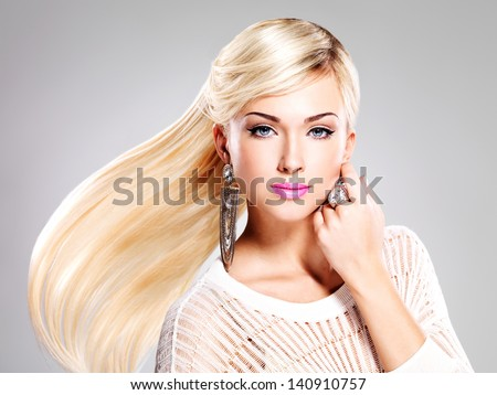 Beautiful woman with long white hairs and bright fashion makeup. - stock photo
