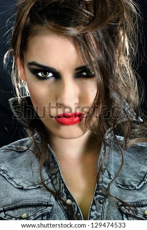 Beautiful woman with luxury luxury evening smoky make-up and curly hair - stock photo