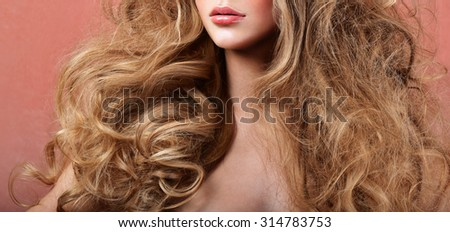 Beautiful woman with magnificent curly hair. professional makeup and hairstyle. - stock photo