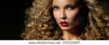 Beautiful woman with magnificent curly hair. Red lipstick. - stock photo