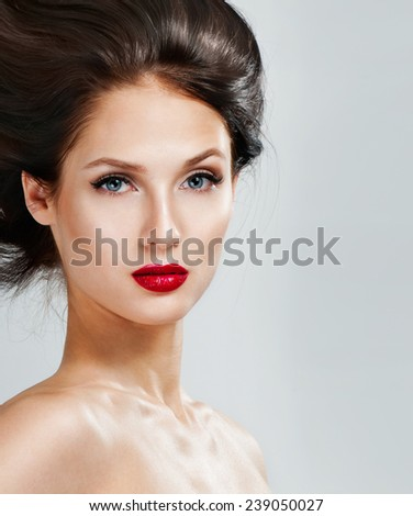 Beautiful woman with magnificent hair.  Red lipstick. - stock photo