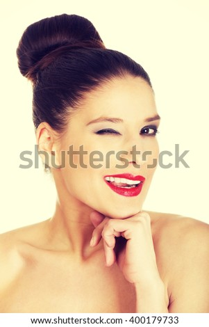 Beautiful woman with make up blinks eye. - stock photo