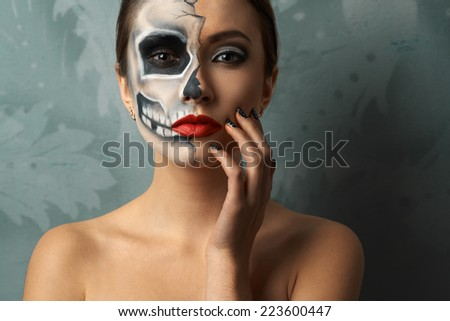 beautiful woman with make-up skeleton - stock photo