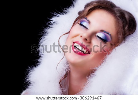 beautiful woman with makeup against black background, Christmas topic - stock photo