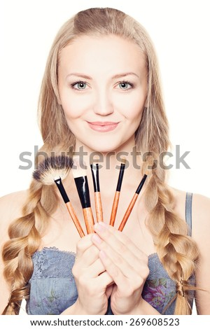 Beautiful Woman with Makeup Brushes. Make-up concept - stock photo