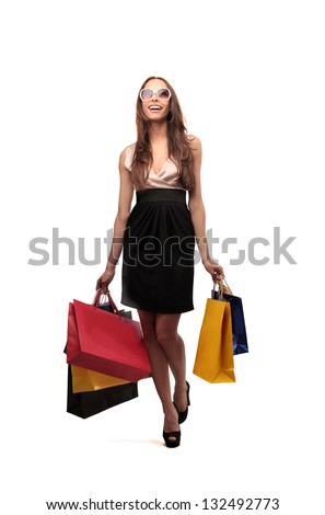 beautiful woman with many shopping bags - stock photo