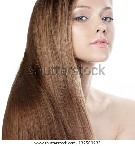 Beautiful woman with natural looking makeup and long brown hair - stock photo