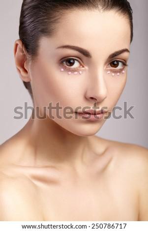 Beautiful woman with natural make-up, perfect skin - stock photo