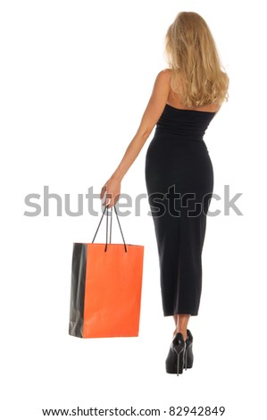 beautiful woman with orange shopping bags on white isolated - stock photo