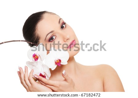 beautiful woman with orchid over white background - stock photo