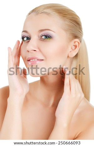 beautiful woman with perfect skin and face. Beauty Portrait. Beautiful Spa Woman Touching her Face. Perfect Fresh Skin. Pure Beauty Model. Youth and Skin Care Concept - stock photo