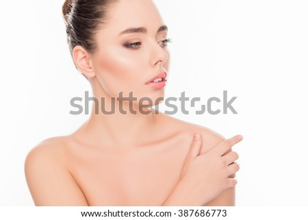 Beautiful  woman  with perfect skin touching her shoulder - stock photo